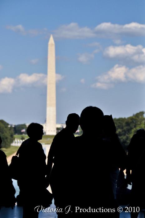 The Washington Monument through the crowd